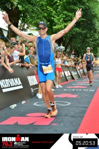 Crossing the finish line of the Ironman 70.3 Zell am See 2017