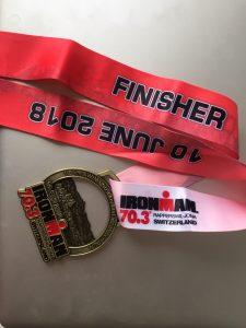 Medal of the 2018 Ironman 70.3 Rapperswil-Jona triathlon