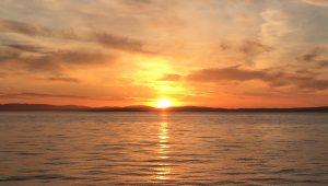 Sunset Irish Sea working offshore
