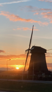 Late afternoon bike ride past a wind mill the Netherlands