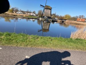 Cycling in Noord-Holland along channels and wind mills