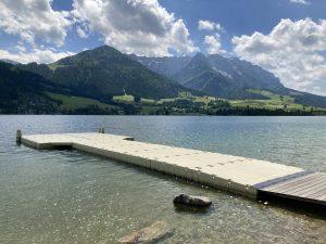 Walchsee lake with swim platform and beautiful mountain scenery